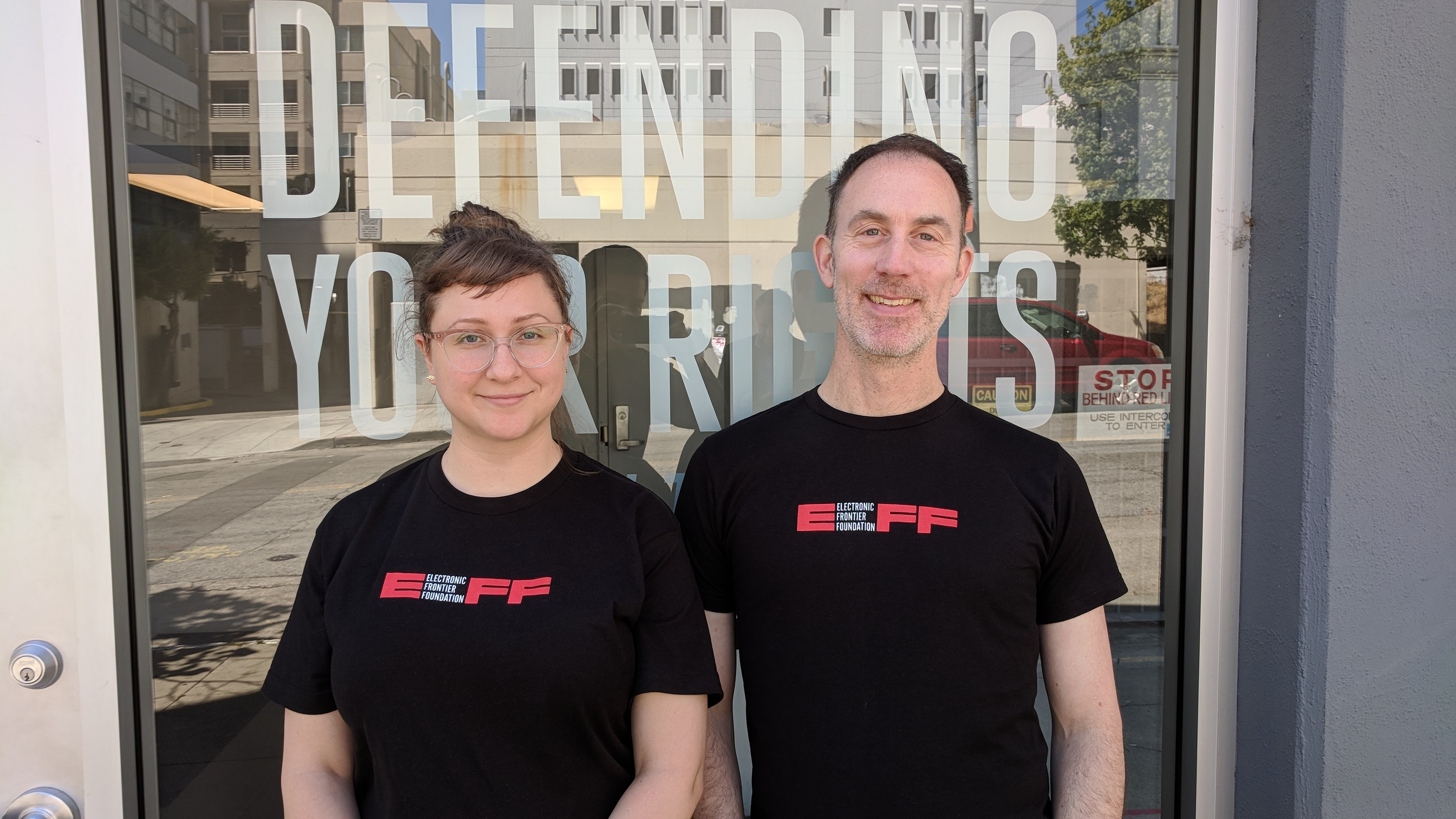 A photo of two EFF staffers wearing the new shirt.