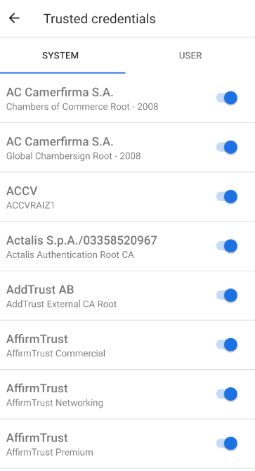 "Android 11's certificate management. The heading says ""Trusted credentials"", and below there is a ""System"" tab, which is selected, and a ""User"" tab. The body contains a list of certificate authorities. Each entry has a toggle button next to it."