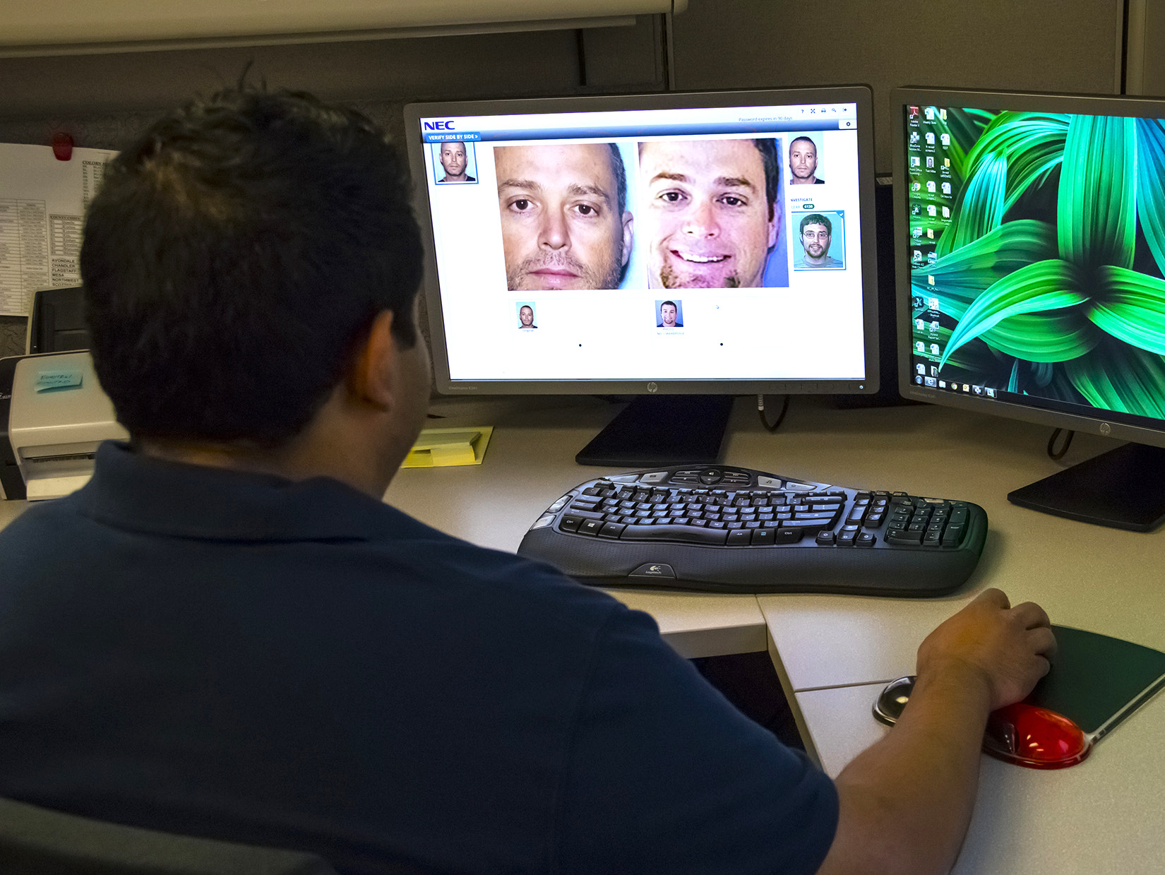 An Arizona Department of Transportation worker sits at a computer, running face recognition software.