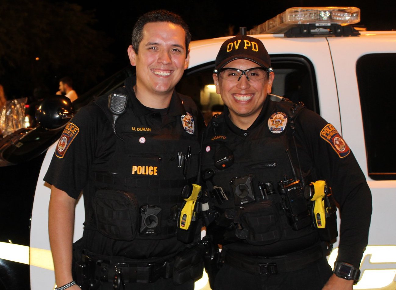 Two police officers wearing body cameras