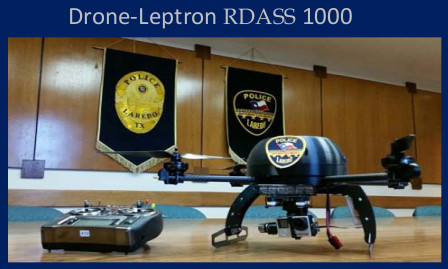 A drone sitting on a desk in front of the Laredo Police Department emblem