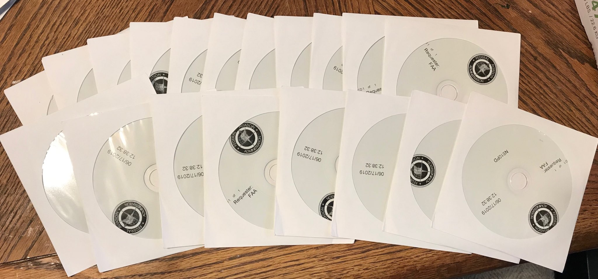 A large number of CD-ROMS in envelopes on a table
