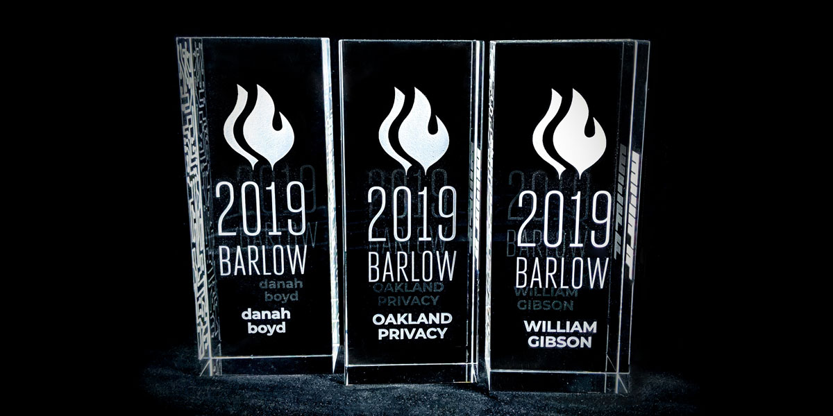 Three rectangular awards in clear acrylic. Front engraved with 2019 Barlow and danah boyd, Oakland Privacy, William Gibson, respectively.