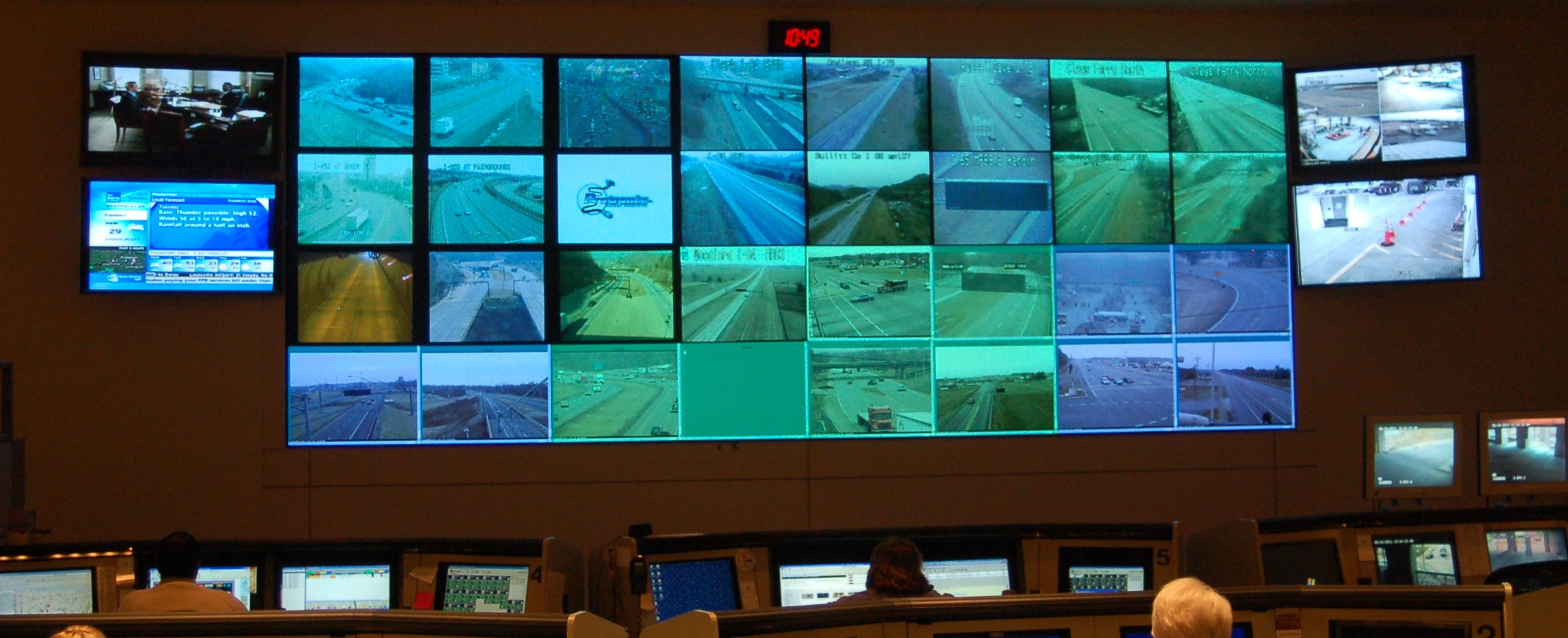 A wall of computer monitors at the Kentucky Intelligence Fusion Center.