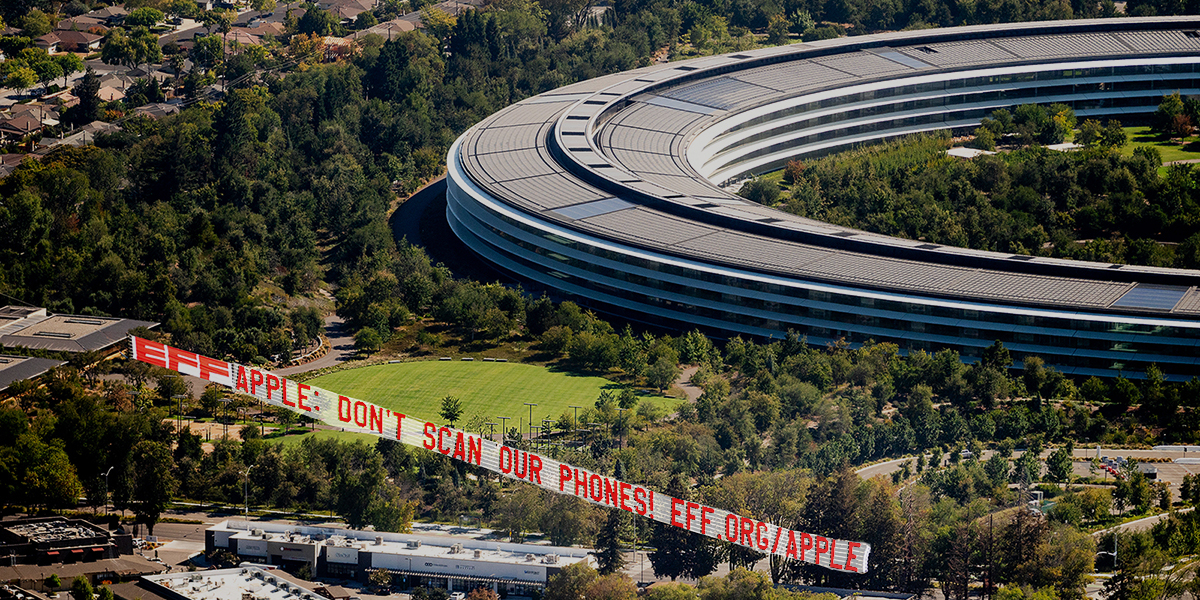 A plane flies a banner over Apple's Cupertino, Calif., headquarters during the company's iPhone launch event on Tuesday, Sept. 14, 2021. It is part of an Electronic Frontier Foundation (EFF) campaign demanding Apple drop its planned iPhone surveillance