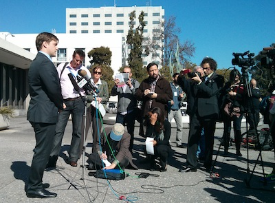 EFF's Trevor Timm speaks to assembled reporters in front of the Alameda County Administration Building.
