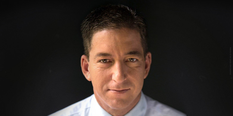 Portrait of Glenn Greenwald against a dark background. Photo by David dos Dantos CC-BY