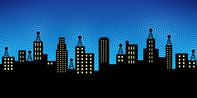 Image of a skyline of buildings with antennas on them.