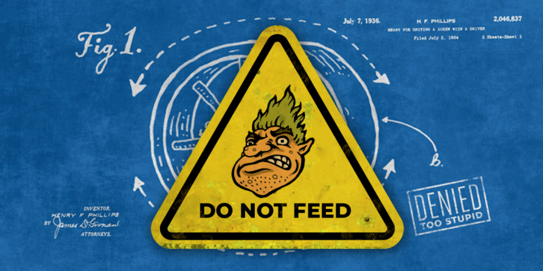 """A warning sign with a picture of a troll says """"do not feed the troll"""""""