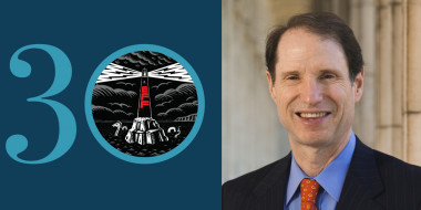 """30"" with an EFF lighthouse in the zero next to Sen. Ron Wyden"