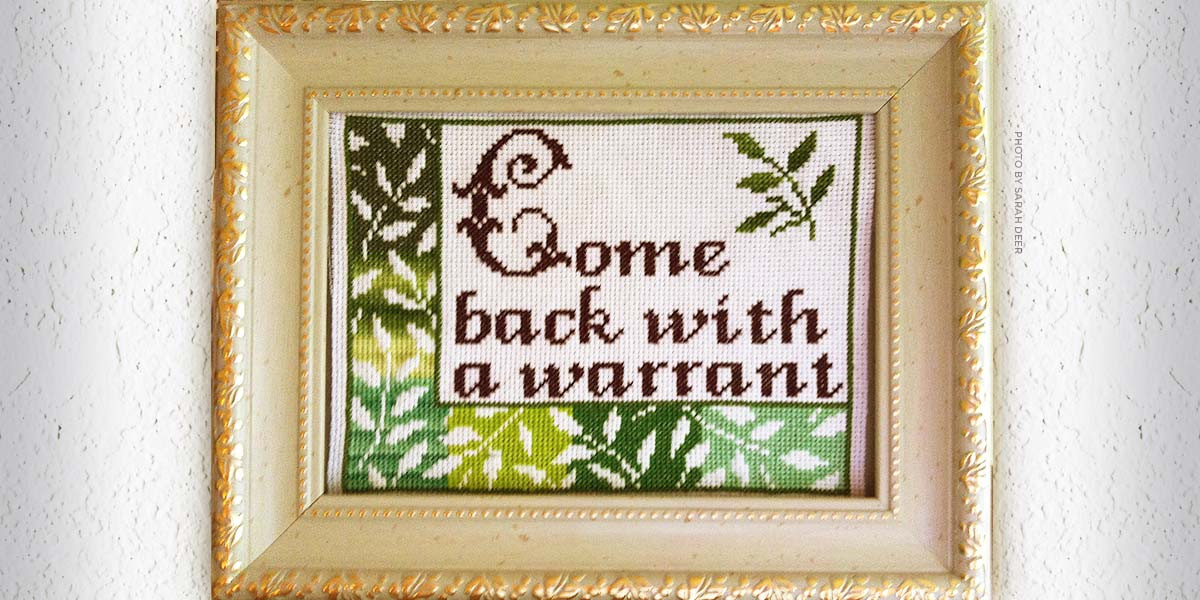 Get a Warrant stitched wall hanging